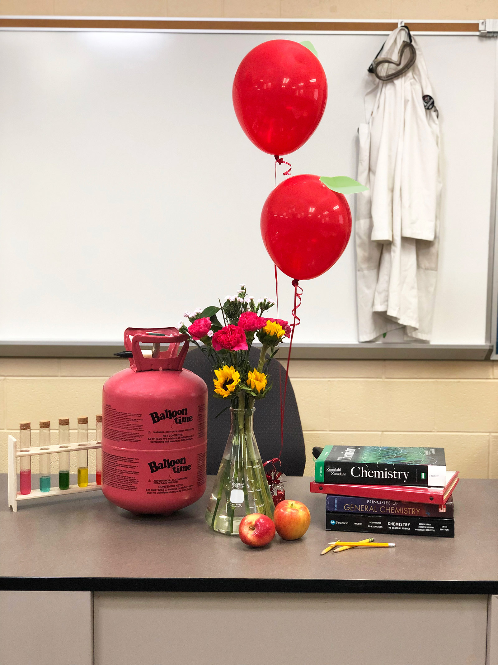 Balloons and helium tank in classroom
