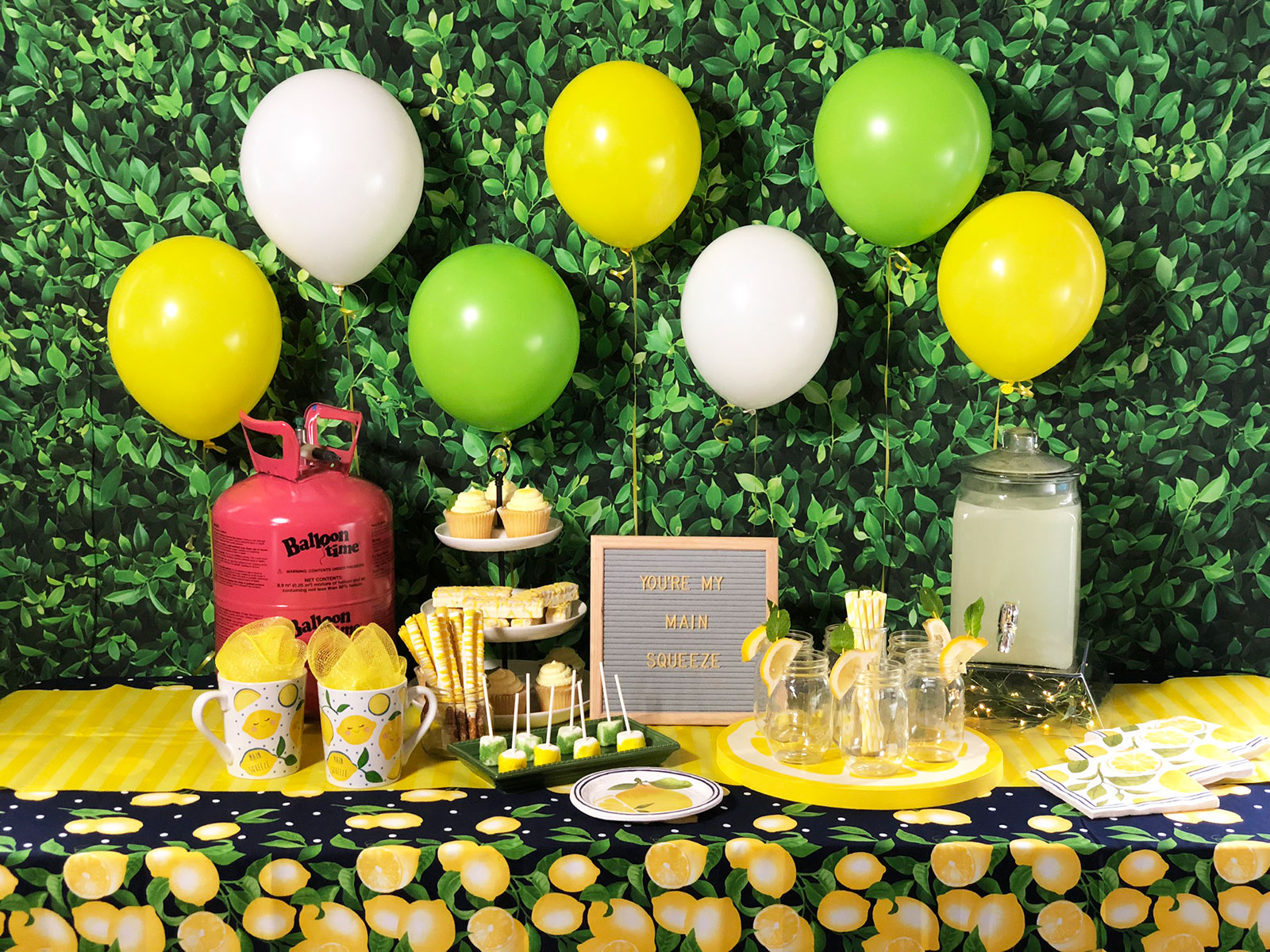 Decorative picnic table with balloon centerpiece