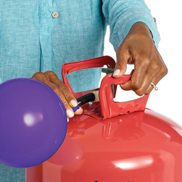 Hands filling latex balloon