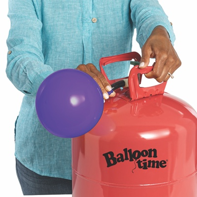 Hand placing balloon on nozzle